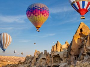 Hot air balloons flying over fairy chimneys in Cappadocia